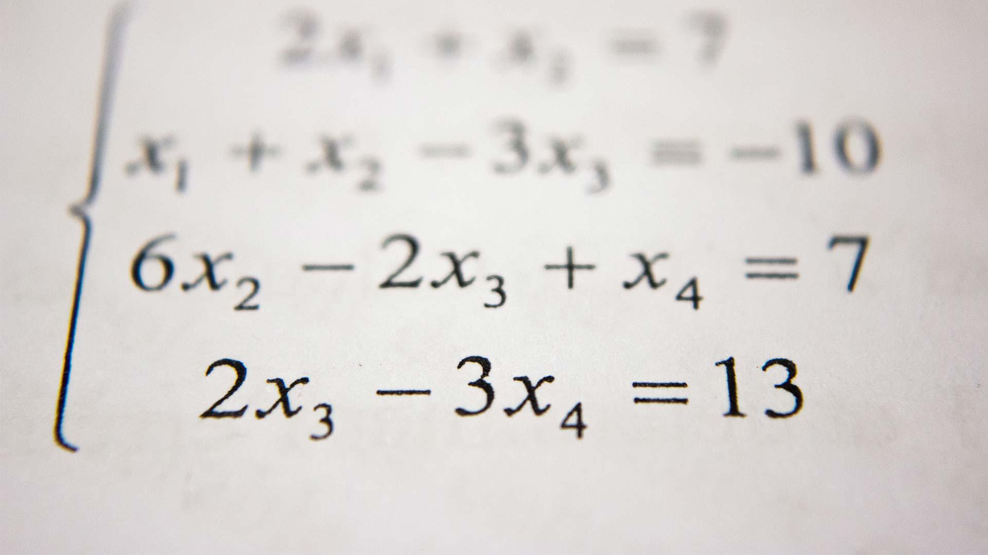 Mathematische Gleichung in einem Buch